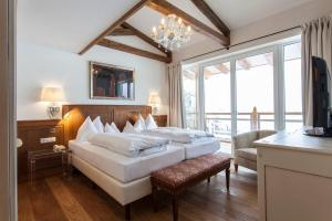 A bed or beds in a room at Theresa Wellness-Genießer-Hotel