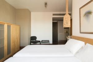 A bed or beds in a room at Barcelona Apartment Aramunt