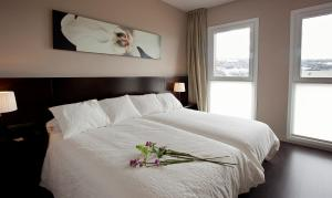 A bed or beds in a room at Hotel Rural Valdorba