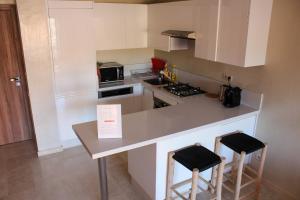 A kitchen or kitchenette at SUBLIME APPARTEMENT AVEC PISCINE SUR LE TOIT