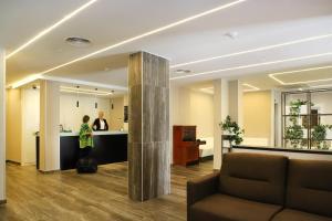El vestíbulo o zona de recepción de Hotel Alameda