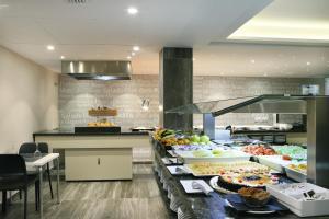 Una cocina o zona de cocina en Hotel Alameda
