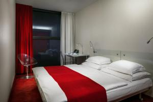 A bed or beds in a room at Design Metropol Hotel Prague