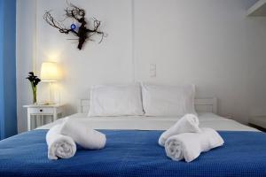 Ένα ή περισσότερα κρεβάτια σε δωμάτιο στο Santorini Mesotopos