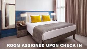 A bed or beds in a room at Staybridge Suites London-Vauxhall