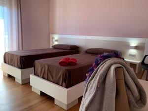 Letto o letti in una camera di Casa Vacanze Five