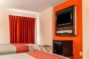 A television and/or entertainment center at Motel 6-Headingley, MB - Winnipeg West
