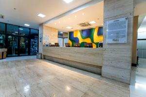 The lobby or reception area at Athos Bulcão Hplus Executive