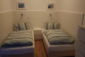 A bed or beds in a room at Ferienwohnung mit eigenem Eingang, wie ein kleines Haus