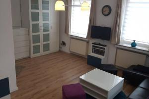 A seating area at Ferienwohnung mit eigenem Eingang, wie ein kleines Haus