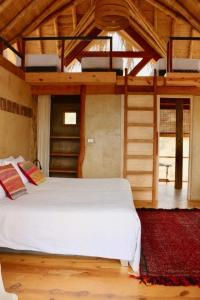 A bed or beds in a room at Amai Luna