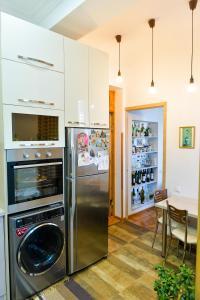 A kitchen or kitchenette at Apartment on Rustaveli Avenue