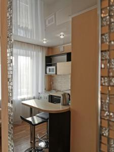 A kitchen or kitchenette at Apartment in Lesosibirsk