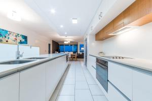 A kitchen or kitchenette at Private Seaview Apartment at Peninsula - Airlie Beach