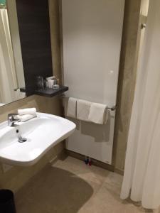 A bathroom at Golden Tree Hotel
