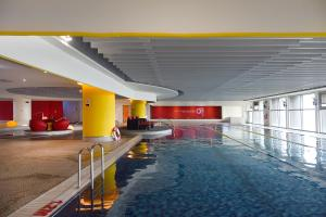The swimming pool at or near Novotel Taipei Taoyuan International Airport