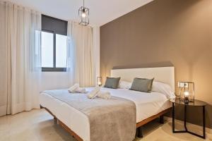 Cama o camas de una habitación en SLEEP Fira by STAY