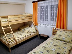 A bunk bed or bunk beds in a room at APARTMAN 99