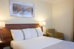A bed or beds in a room at Holiday Inn Ipswich