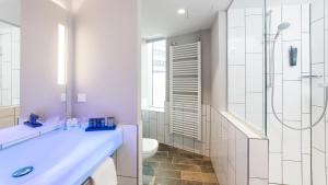 Ein Badezimmer in der Unterkunft Holiday Inn Hamburg - City Nord