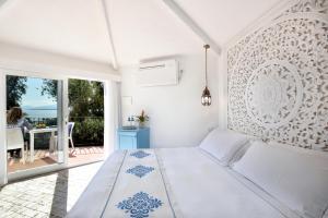 Letto o letti in una camera di Arbatax Park Resort - Dune
