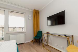TV a/nebo společenská místnost v ubytování Warsaw To Be - Golden Apartment