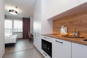 Kuchyň nebo kuchyňský kout v ubytování Warsaw To Be - Easy Apartment