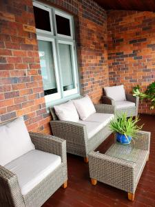 A seating area at Two up on York