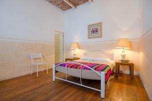 A bed or beds in a room at Casa San Ildefonso