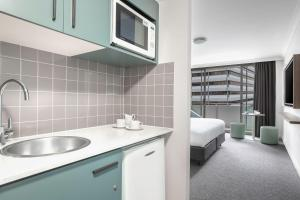A kitchen or kitchenette at Mantra Chatswood
