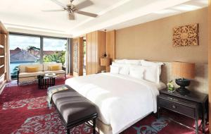 A bed or beds in a room at Hotel Indigo Bali Seminyak Beach