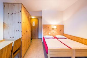 A bed or beds in a room at Davos Youth Hostel