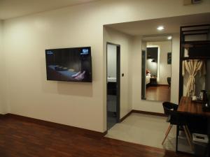 A television and/or entertainment center at Laluna Hotel And Resort, Chiang Rai