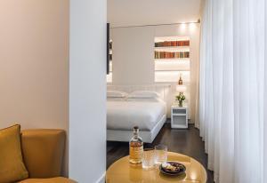 Cama o camas de una habitación en Magna Pars l'Hotel à Parfum