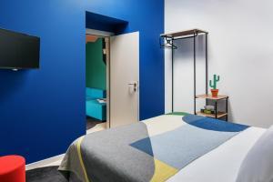 Letto o letti in una camera di TSH Florence Lavagnini