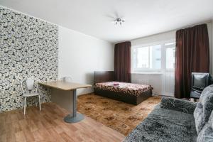 A bed or beds in a room at Квартира в новом доме на Выборной