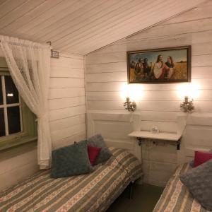 Säng eller sängar i ett rum på Timjan Forest Resort