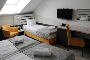Krevet ili kreveti u jedinici u okviru objekta Garni Hotel 11tica DM