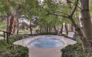 The swimming pool at or near ARIA Resort & Casino