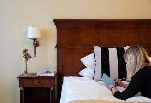 A bed or beds in a room at Leopolis Hotel