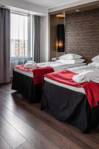 Ein Bett oder Betten in einem Zimmer der Unterkunft Tallink Hotel Riga