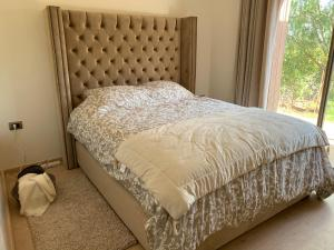 A bed or beds in a room at Prestigia Golf Piscine