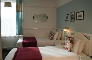 A bed or beds in a room at The Telstar