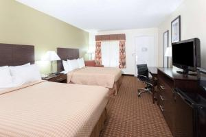 A television and/or entertainment center at Super 8 by Wyndham Decatur/Dntn/Atlanta Area