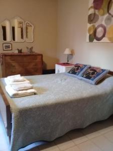 Una cama o camas en una habitación de La María