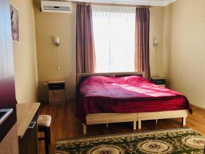 Кровать или кровати в номере Гостевой дом Акварель