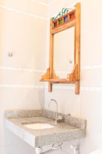 Um banheiro em Pousada Mucuripe