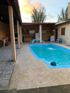 The swimming pool at or close to Hostel das Oliveiras
