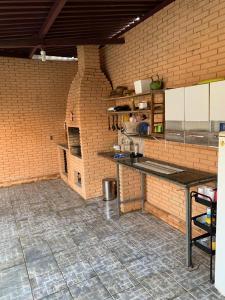 A kitchen or kitchenette at Hostel das Oliveiras