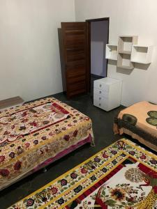 A bed or beds in a room at Hostel das Oliveiras